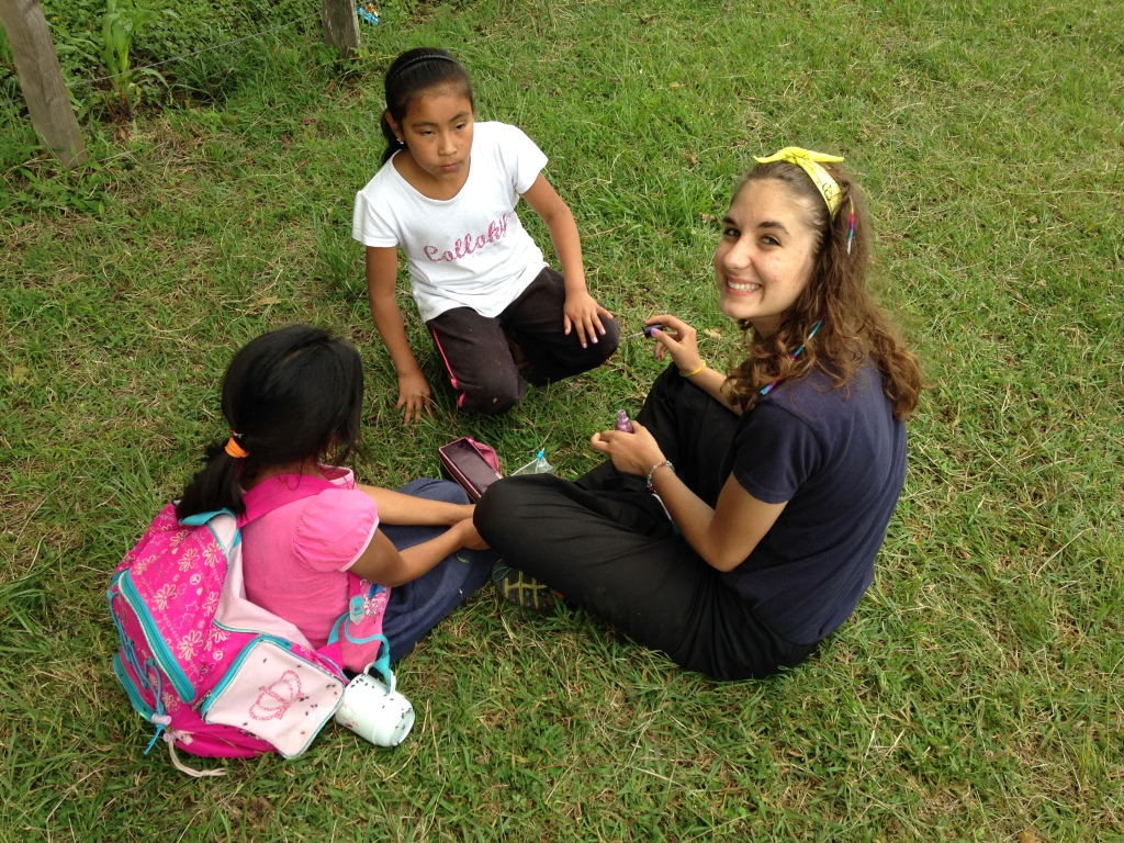 Mina, as well as many others, were playing with the kids from the school.  In this picture, she was painting nails.