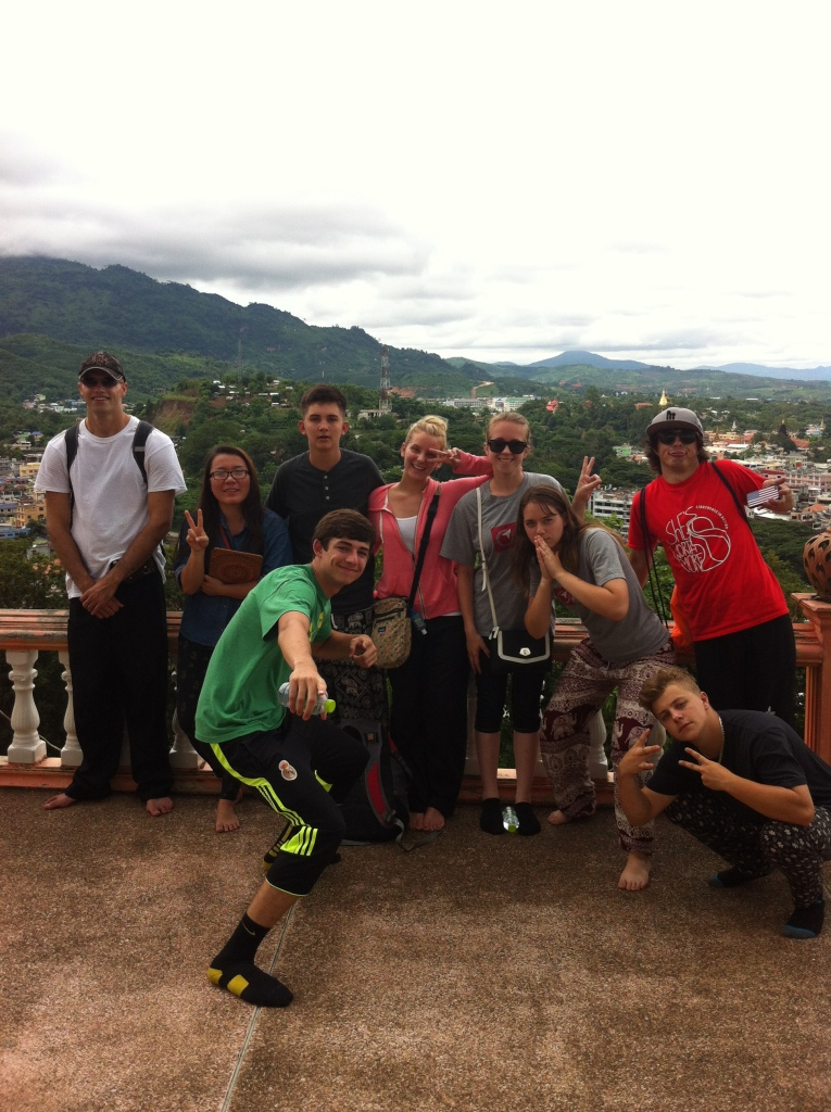 The team along with Rung at a huge Buddhist temple in Mae Sai, Thailand, but in the background you see across the border into Burma (Myanmar).